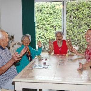 laughter and games around the table at HooNani Day Center