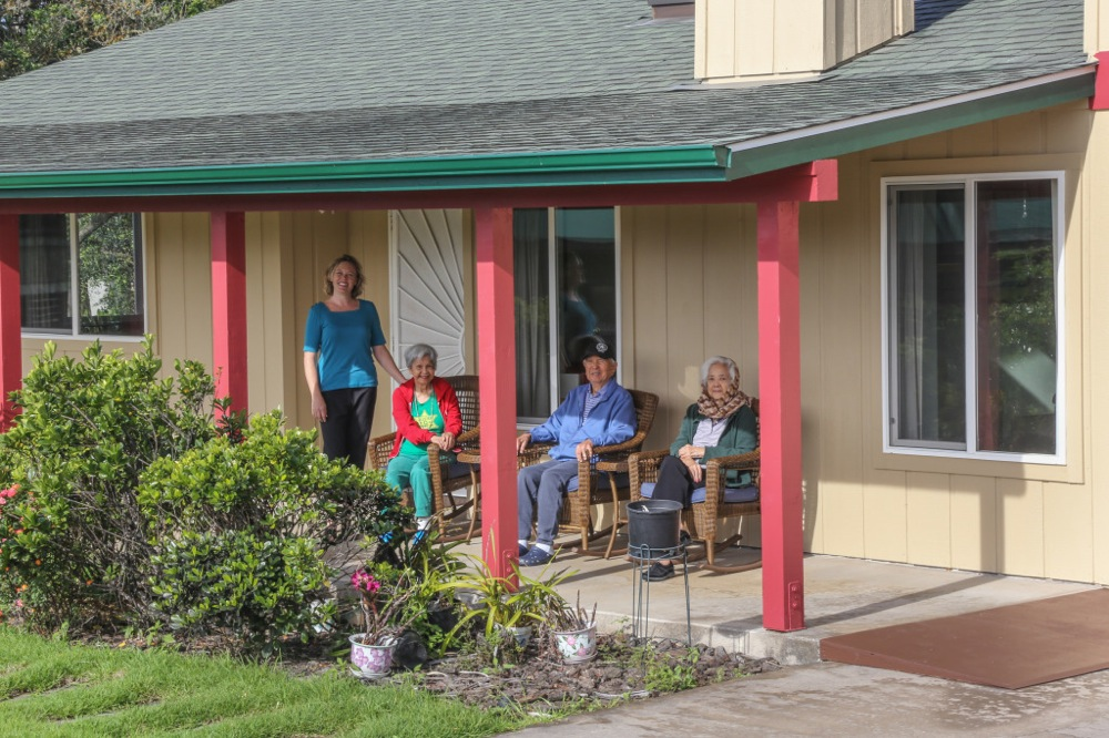 residents of HooNani Care Home relax outdoors on the lanai